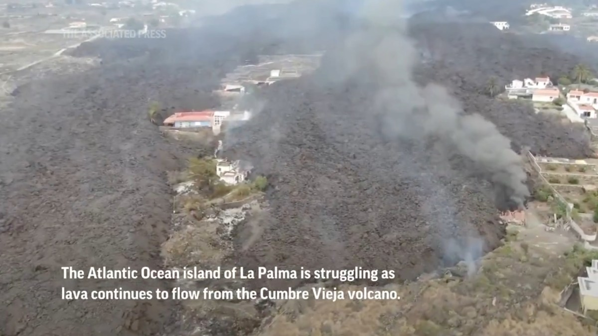 Watch 40-foot wave of lava destroy everything in its path in Spain's La Palma Island