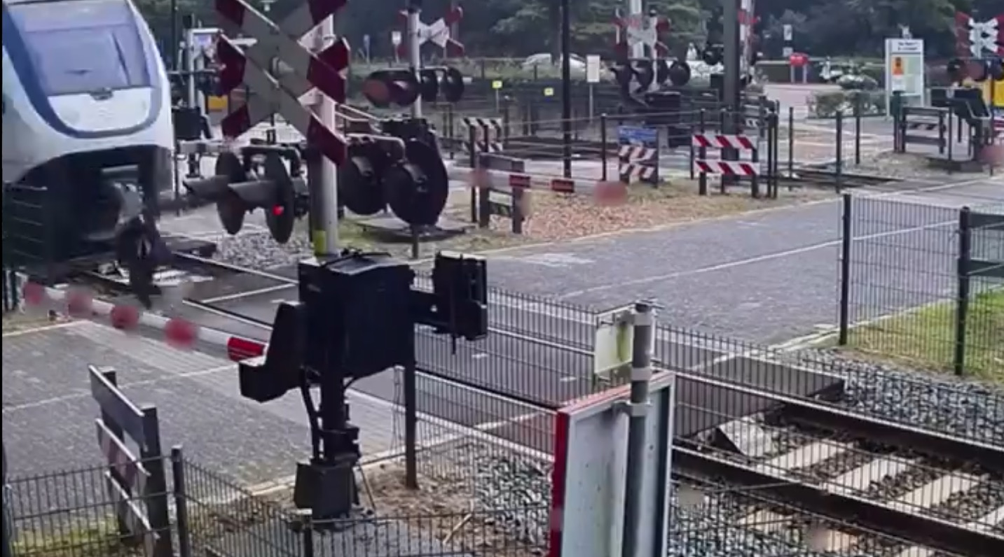 Woman runs back and forth across train tracks and almost gets squashed