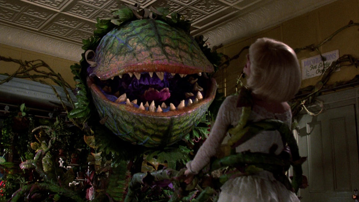 """Screenshot of Audrey attacking a woman in """"Little Shop of Horrors"""""""