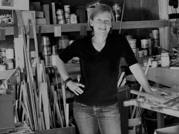 Rebecca Klundt standing in her studio