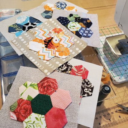 quilt blocks with colorful hexi flowers