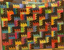 quilt with bright colors alternating with black