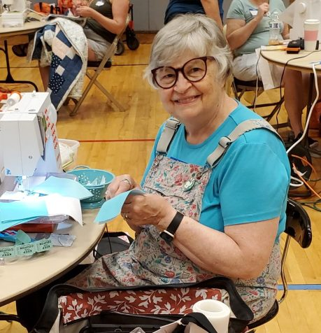 smiling woman sewing