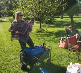 woman holding up knitting proejct