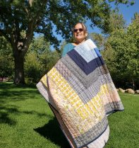 woman holding quilt in the park