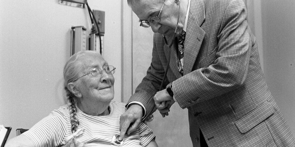 Dr. Jesus Dapena is checking a patient's blood pressure at his small hospital on Grand Manan island off the coast of New Brunswick.