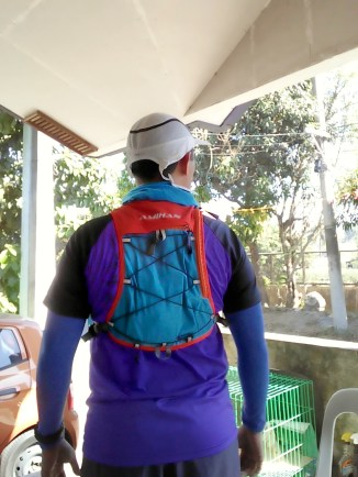 Running vest secured properly with side and front adjustable straps