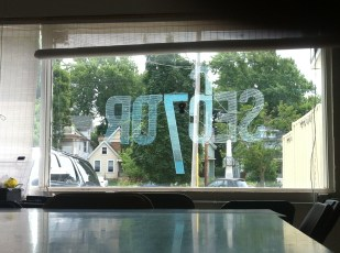 Sector 67 Logo on the window at Sector drawn in reverse