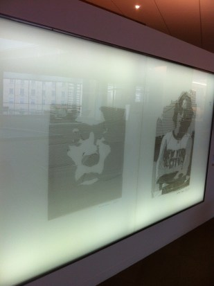Drawings of Miles Davis and John Lennon inside the Wisconsin Institute for Discovery