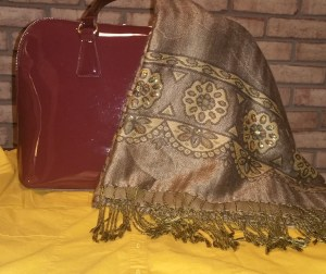Mustard shirt, burgundy handbag and olive embellished fringed wrap