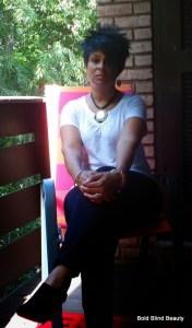 Sitting on my balcony wearing an edgy asymmetrical wig.