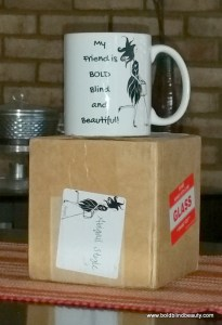 Mug is sitting on top of the box in which it will be shipped.