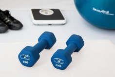 hand weights, scale, exercise ball and sneakers