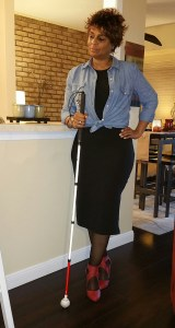 Standing profile pose with white cane.