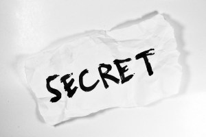 """The word """"secret"""" on a piece of paper"""