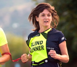 Rick Egan | The Salt Lake Tribune Friday, July 31, 2015 (Close up of Becky running tethered to her running partner)