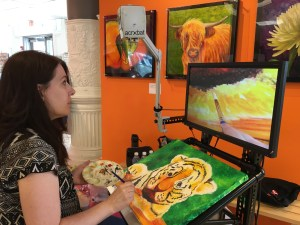 Suzanne is using a CCTV to paint a tiger.