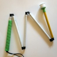 Ambutech White Cane with a neon green grip and neon yellow section nearest the tip.