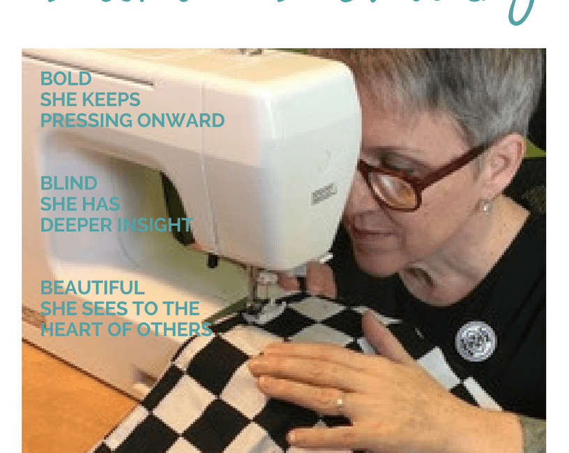 Blind Beauty Issue 27 Libby Thaw is pictured sitting at her sewing machine working with a black & white checkered patterned material. Full image description is in the body of the post.