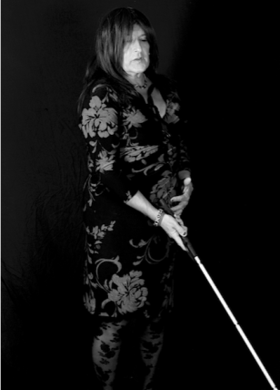 Image of Carla and her white cane is described in the post.