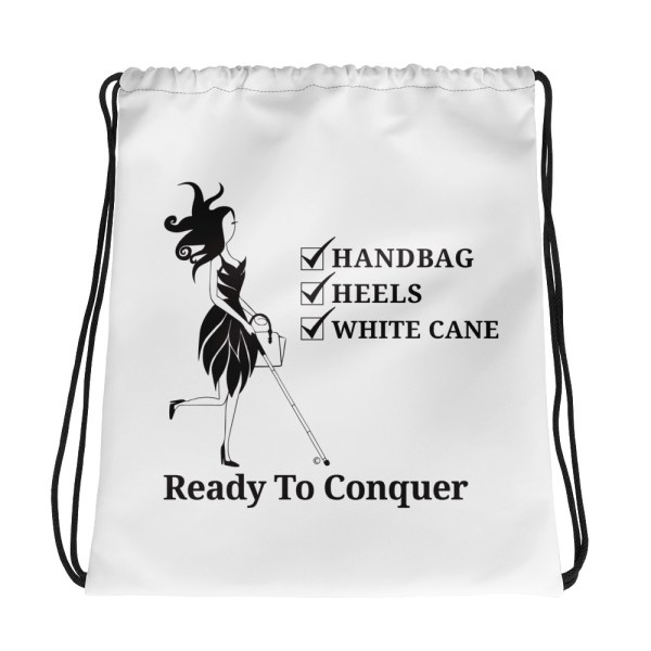 "White drawstring bag w/black ink. The fashion icon Abby and checklist is front and center. Checklist says ""Handbag, Heels, White Cane."" Directly under Abby and the checklist are the words ""Ready To Conquer"""
