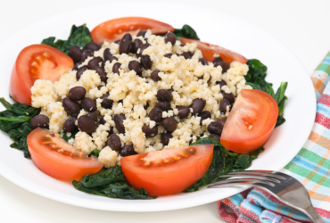 Millet and black beans with tomatoes and spinach.