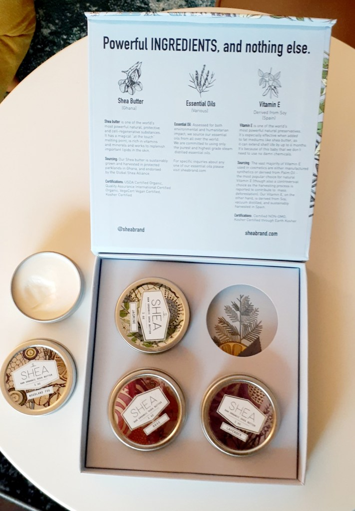 Open Shea Butter Gift Box displaying Jasmine, Woodland Fog, Rose, and Lavender tins of shea butter.
