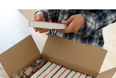 Author opens a package with samples of her new book and checks the hardcover