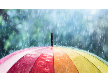 The header is a multi-colored umbrella with rain showers upon it