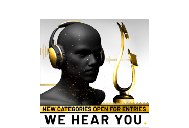 """A genderless bust wearing gold and dark gray headphones faces a teardrop-shaped golden statue -- an artistic rendition of a microphone and pop filter atop a round base. Below, the text """"New Categories Open For Entries."""""""