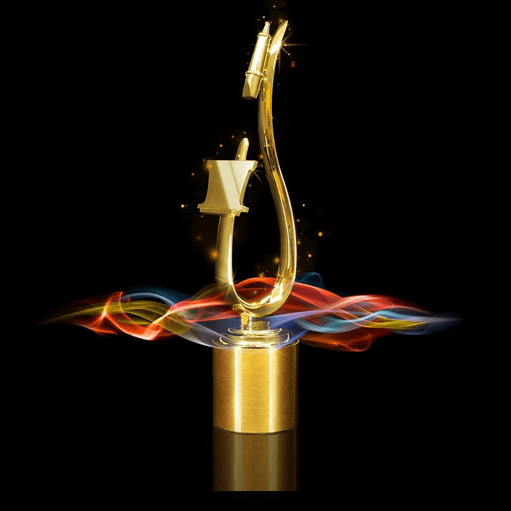 A teardrop-shaped golden statue -- an artistic rendition of a microphone and pop filter atop a round base against a black background.