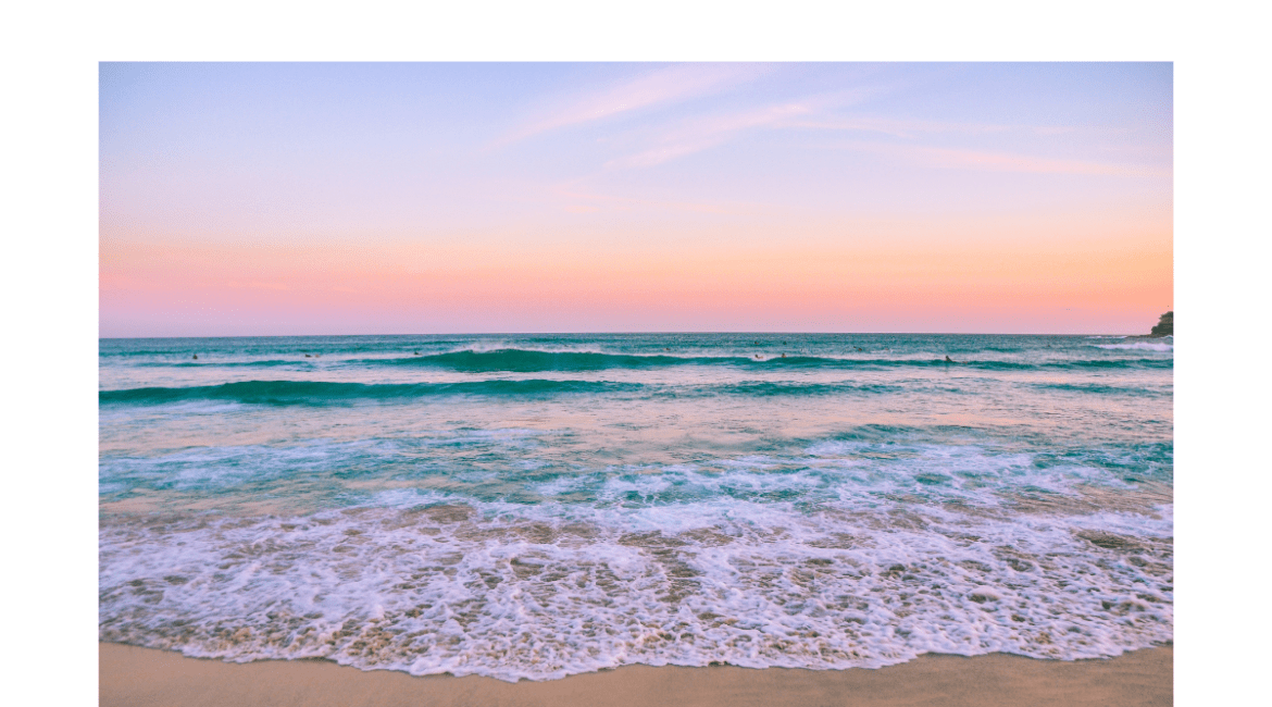 The header photo is a sunset on the beach with pale pink, orange and yellow hues on the horizon and white foamy waves lapping the beach.