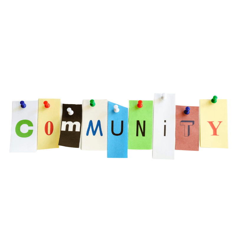 """""""Community"""" is spelled out in individual letters on multi colored strips of paper pinned to wall."""