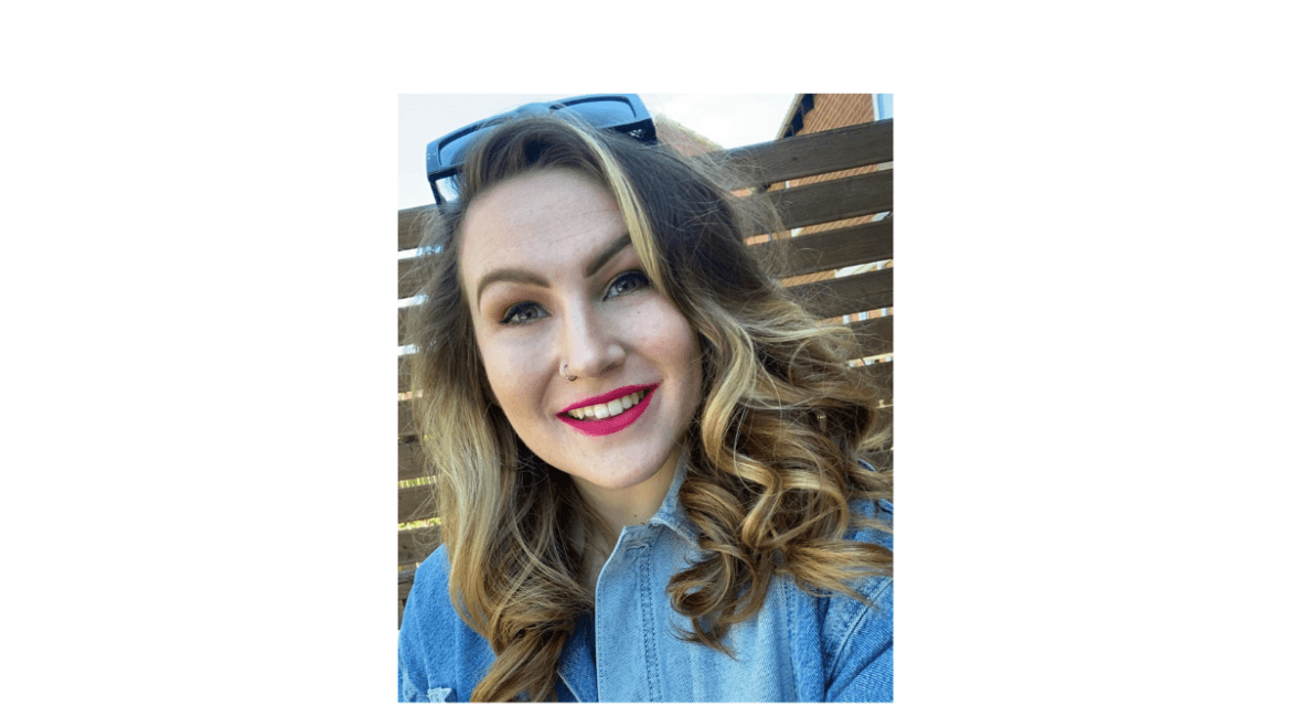 The header image is a headshot of Molly smiling with sunglasses on top of her head. Her blond/brown hair is cascading over her shoulders in loose curls and she's wearing a chambray shirt.