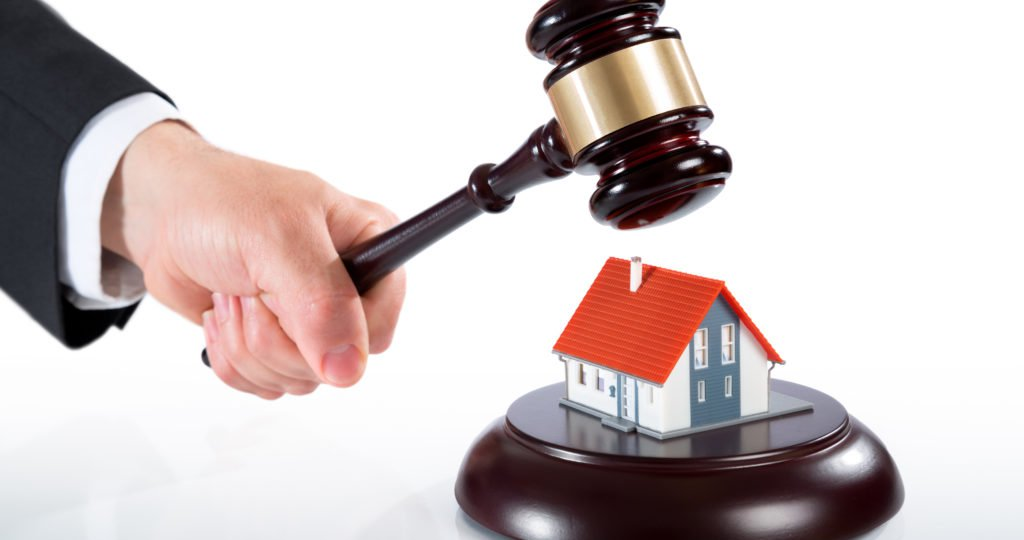 gavel on house - auction of real estate