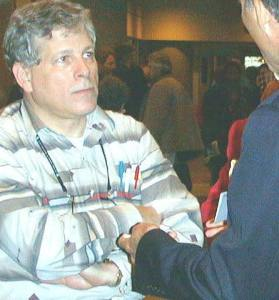 This photo says it all... Terry Polevoy MD (left) being confronted by health humanitarian and world renowned author Leonard Horowitz DDS, PhD (right).