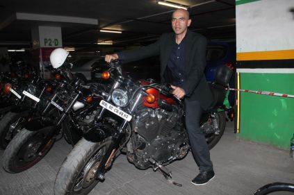 Kamal Shah (Producer) posing with Harley Davidson at the premiere of 'Love, Wrinkle-Free' at PVR, Phoenix.