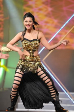 Shruti Haasan shows her moves during the 60th Filmfare Awards...
