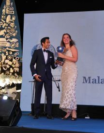Rahul Khanna giving an award to winner at 'The Lonely Planet Magazine India Travel Awards 2014'