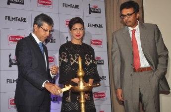 Mr. Tarun Rai (CEO, WWM), Priyanka Chopra & Mr. Varun Berry (MD, Britannia Industries) while lighting diya at the Press Conference of '60th Britannia Filmfare Awards 2014' at JW Marriot.2