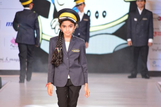 A child dressed up as a pilot at the Kidzania Parade at IKFW 2015