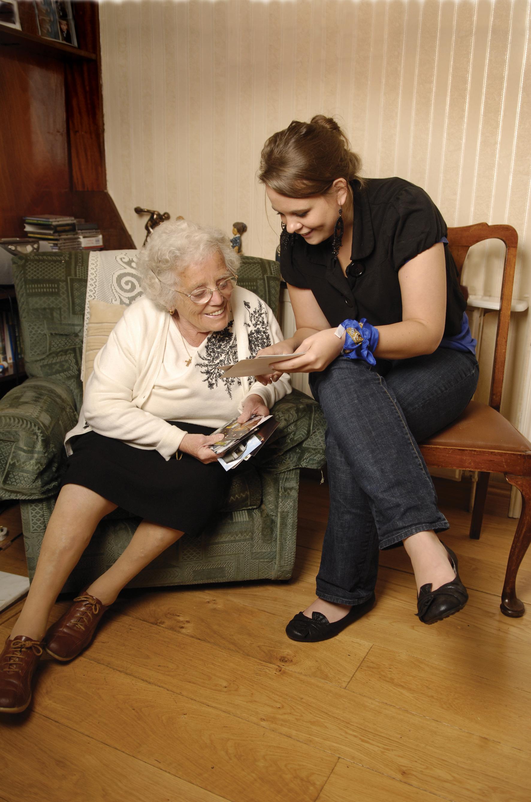 woman-visiting-elderly-woman