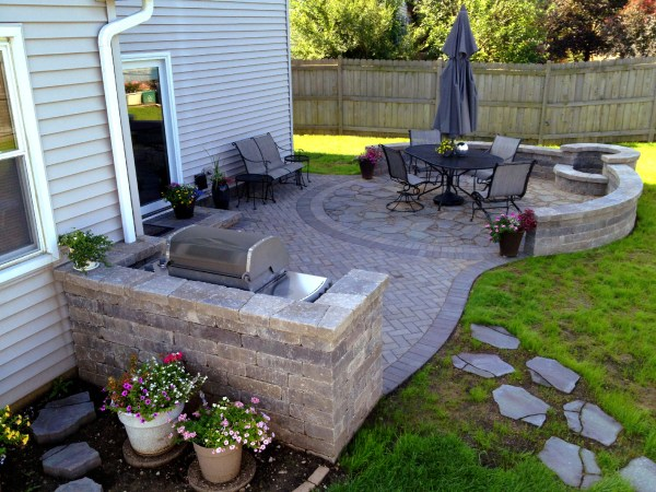 paver patio with fire pit design ideas Should I Use Concrete or Pavers for My Chicagoland Patio