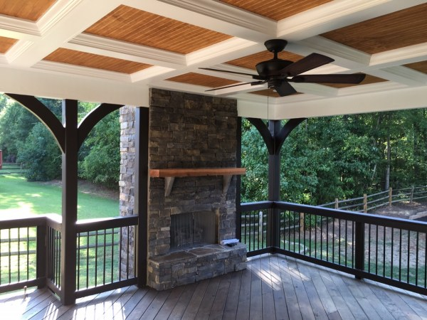 outdoor covered patio with fireplace Charlotte deck builder near me, porch builder near me