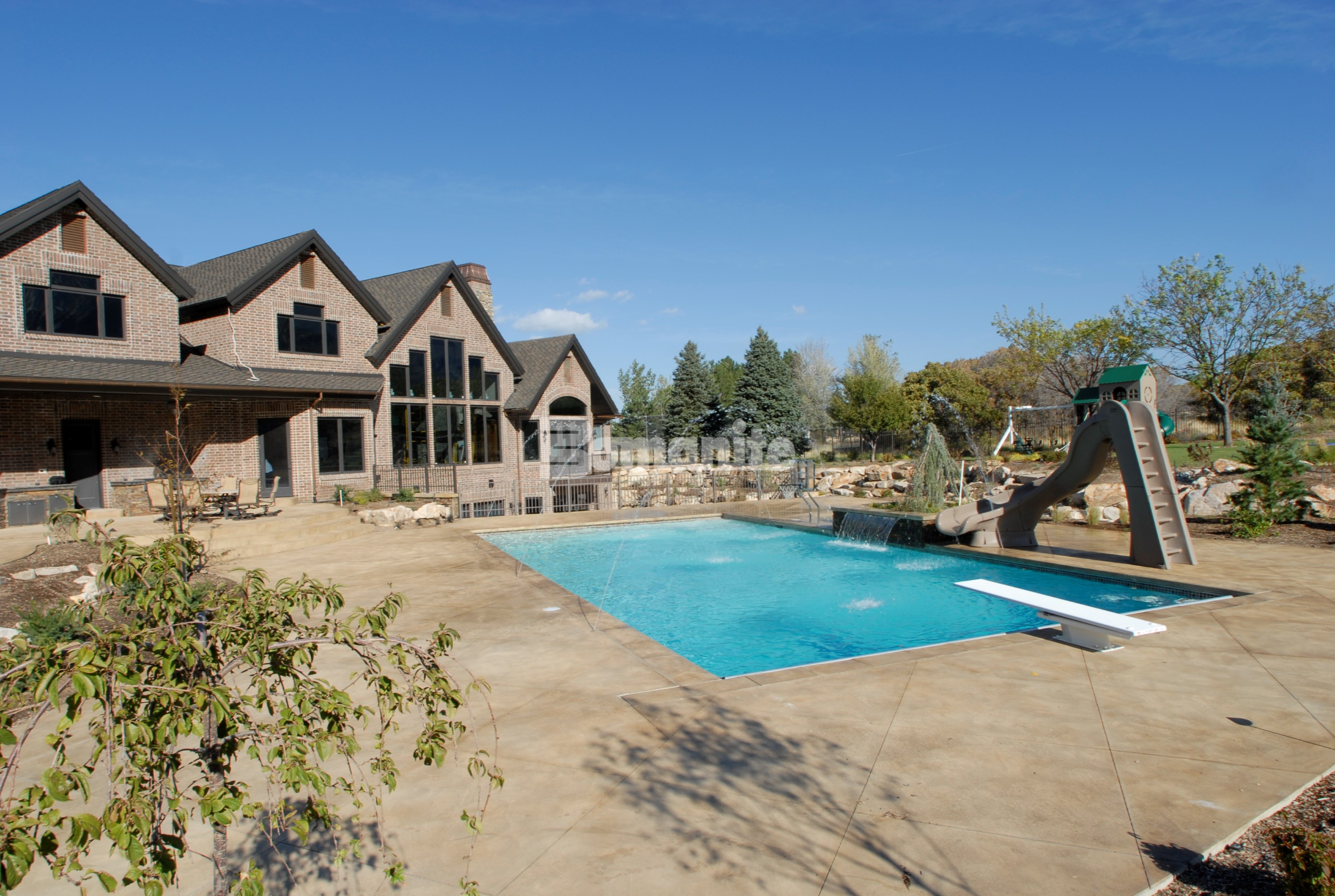 bomanite imprinted concrete is installed to create a utah nature inspired backyard bomanite