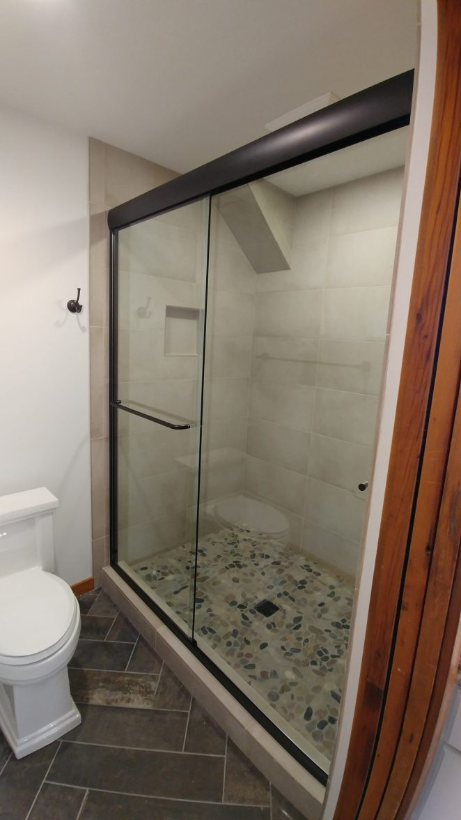 Shower with stone floor tiles
