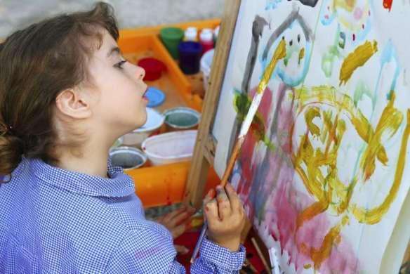 artist school little girl painting brush watercolors portrait