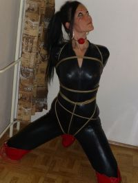 Awesome Brunette in Latex Catsuit and Boots Gets Tightly Bound for Fun