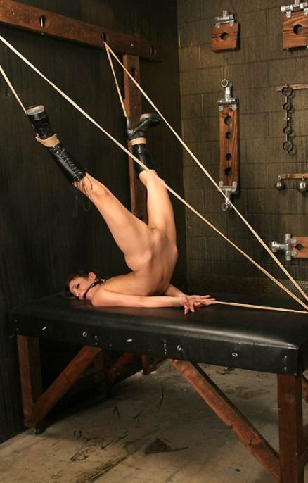 Beautiful Brunette in High Heel Boots Restrained and Gagged in Dungeon