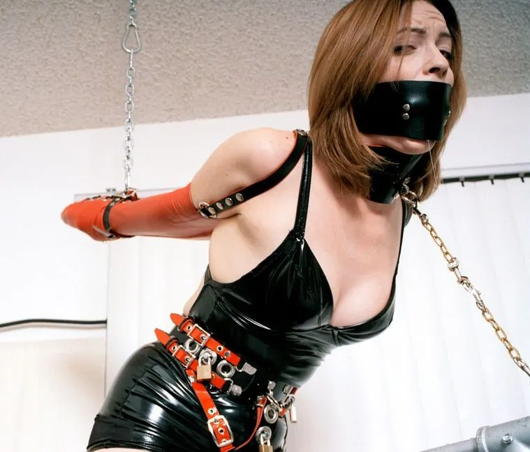 Beautiful Brunette in Latex and Arm Binder Gets Collared and Trained